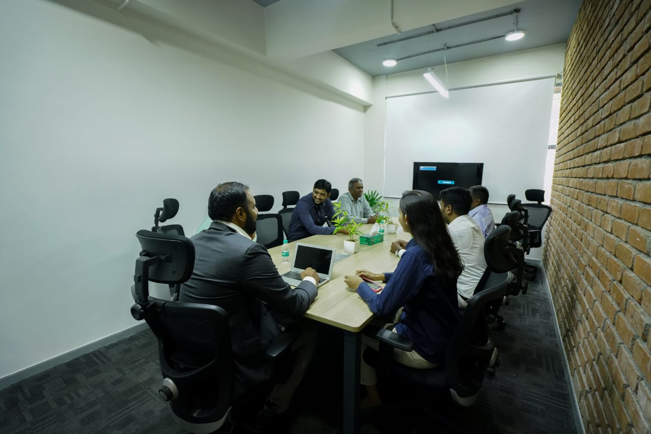 People discussing in meeting room